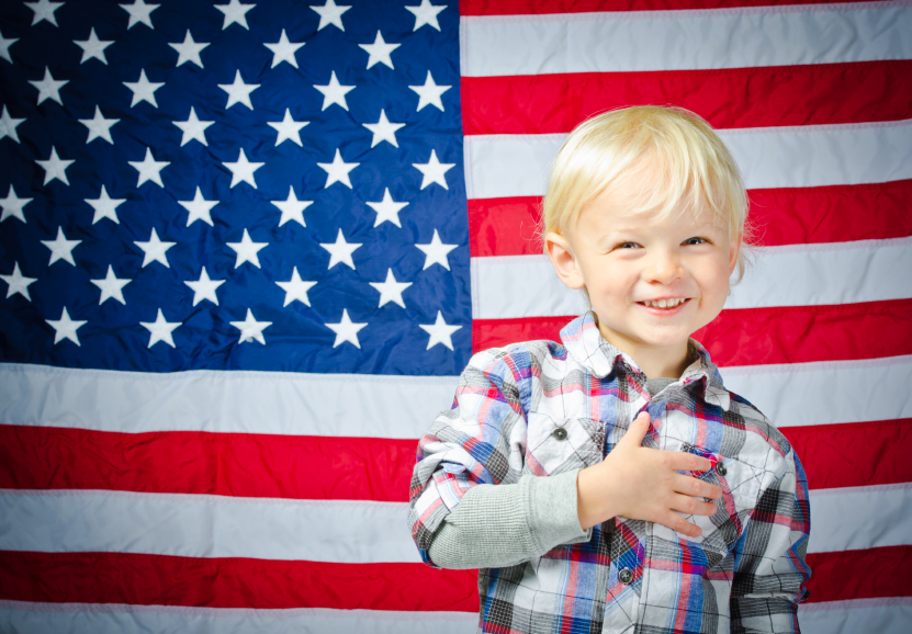 Boy in front of American flag